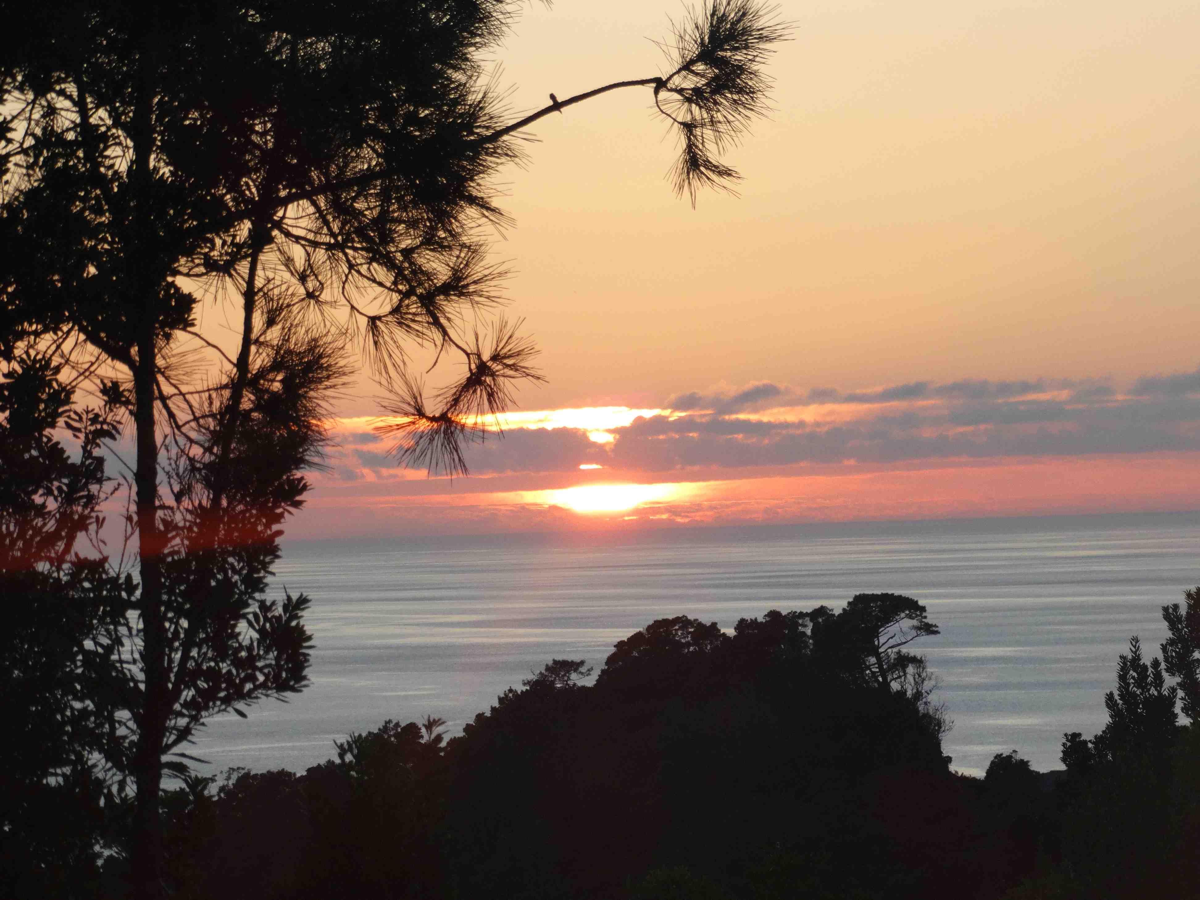 Zonsondergang vanuit jacuzzi